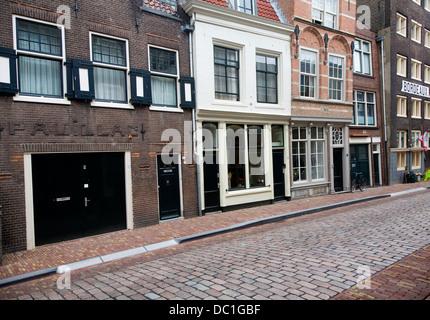 Wine traders homes in historic Wijnstraat cobbled street buildings Dordrecht Netherlands - Stock Photo