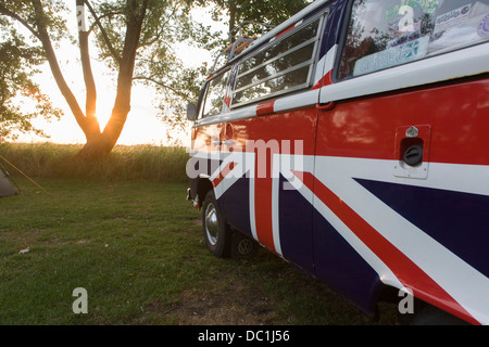 A VW camper van adorned with British Union Jacks colours, on a campsite at Reedham on the Norfolk Broads (more caption - Stock Photo