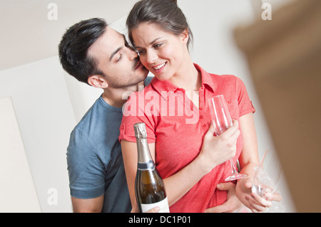Young couple celebrating with champagne - Stock Photo