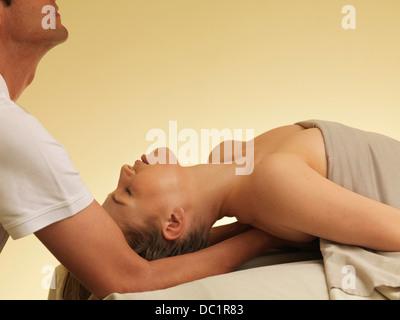 Young woman having back massage - Stock Photo