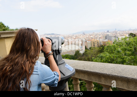 Young female tourist looking at view of Barcelona, Spain - Stock Photo