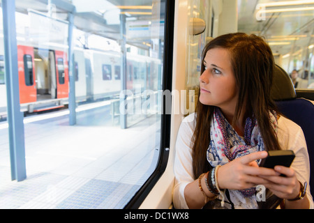 Young female tourist on local train, Catalonia, Spain - Stock Photo