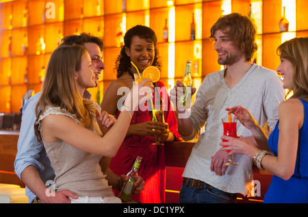 Group of friends enjoying drinks in bar - Stock Photo