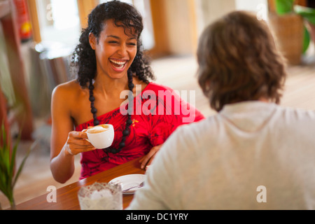 Young couple having coffee in cafe - Stock Photo