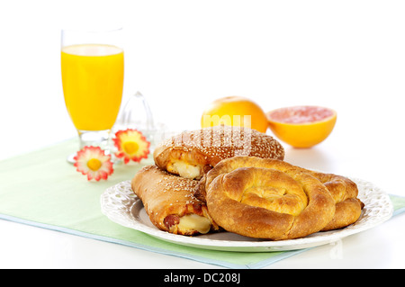 traditional greek breakfast with homemade pies and fresh juice - Stock Photo