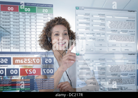 Customer service operator using interactive screen - Stock Photo