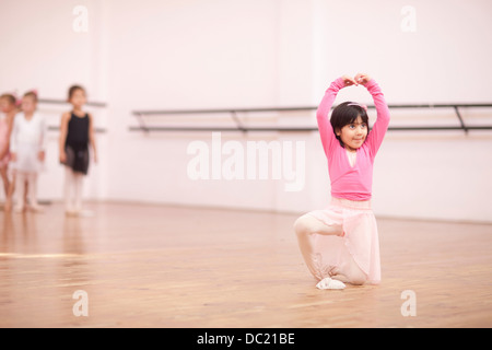 Young ballerina posing in studio - Stock Photo
