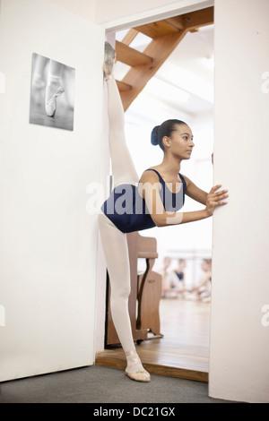 Portrait of teenage ballerina in doorway - Stock Photo
