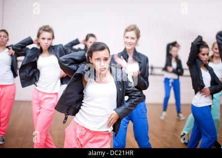 Group of teenagers practicing dance in studio - Stock Photo