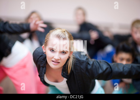 Teenagers practicing hip hop dance in studio - Stock Photo