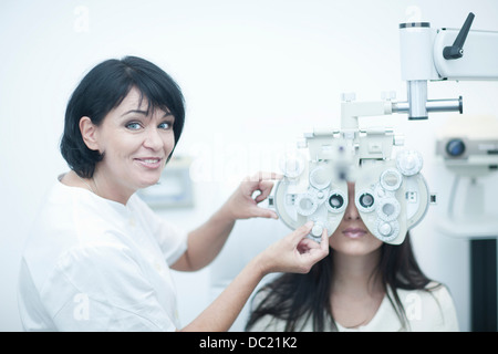 Young woman having eyes tested - Stock Photo
