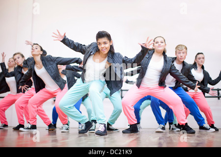 Large group of teenagers dancing in studio - Stock Photo