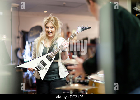 Young couple in music store - Stock Photo