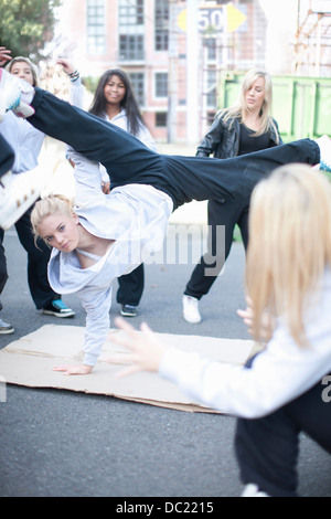 Girl breakdancing in playground - Stock Photo