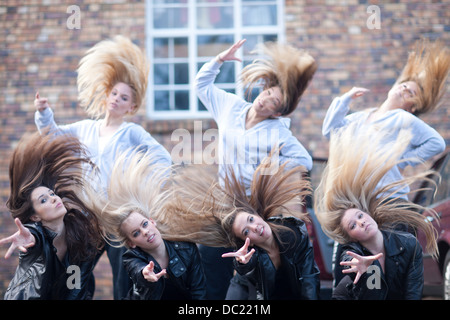 Group of girls practicing dance in carpark - Stock Photo