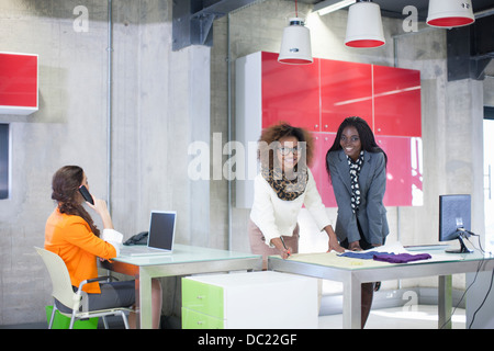 Young women in creative office - Stock Photo
