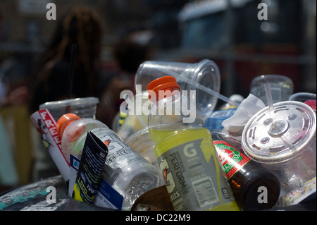An overflowing trash basket seen in the Bushwick neighborhood in Brooklyn in New York - Stock Photo