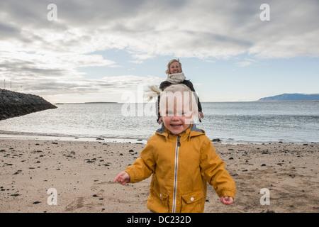 Grandmother and toddler at coast - Stock Photo