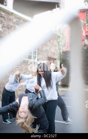 Group of girls dancing in playground - Stock Photo