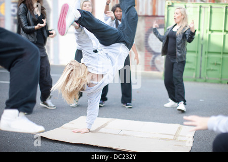 Group of girls breakdancing in playground - Stock Photo