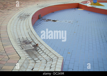 Empty Wet Off-season Swiming Pool With Channel Cover and Leafs - Stock Photo