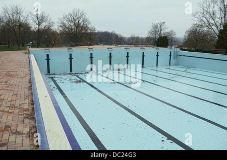 Abandoned Empty Swimming Pool with Fallen Leafs at Autumn - Stock Photo