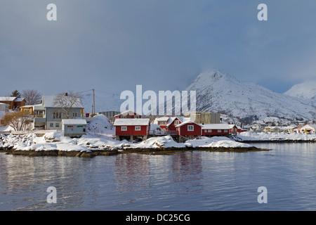 Rorbuer cottages at Svolvaer / Svolvær in the snow in winter, Austvågøy / Austvågøya Vågan, Lofoten Islands, Norway, - Stock Photo