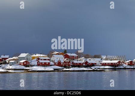 Rorbuer cottages in harbour at Svolvaer / Svolvær in snow in winter, Austvågøy / Austvågøya Vågan, Lofoten, Norway, - Stock Photo