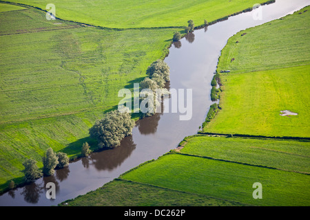Aerial view over farmland and bend in the river Eider among fields at Rendsburg, Schleswig-Holstein, Germany - Stock Photo