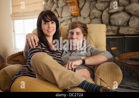 Portrait of couple sitting on armchair - Stock Photo