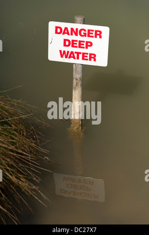 Danger deep water sign in a a lake UK - Stock Photo