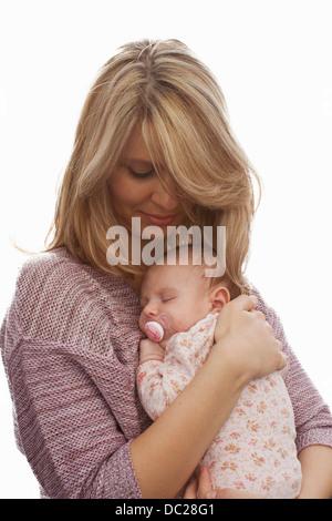 Mother holding newborn baby daughter - Stock Photo