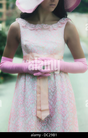 detail view of a girl with pink gloves - Stock Photo