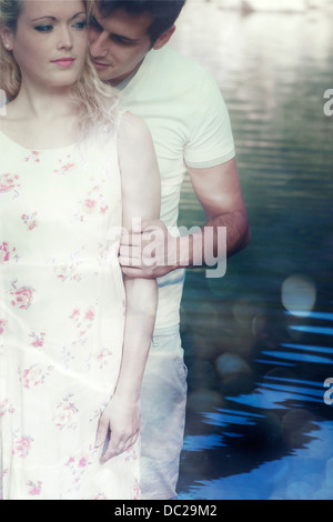 a couple in water, hugging - Stock Photo