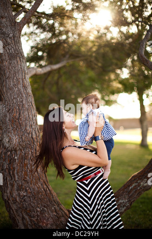 Portrait of mother holding baby daughter - Stock Photo