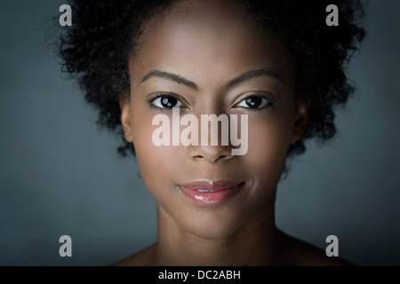 Portrait of woman with afro hair - Stock Photo