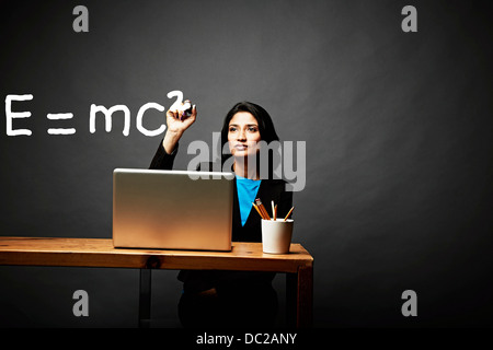 Woman solving a mathematical equation - Stock Photo