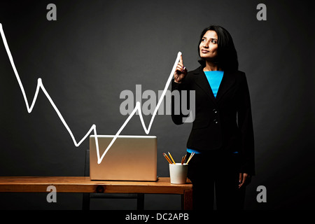 Woman drawing line graph - Stock Photo
