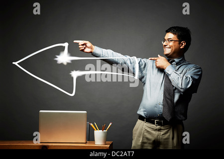 Man pointing the way with a big smile - Stock Photo