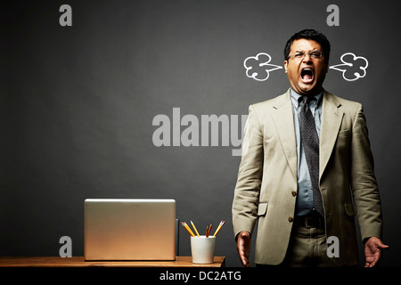 Man shouting and fuming - Stock Photo