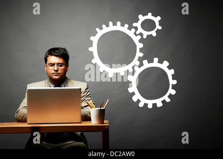 Conceptual image of man as cog in the wheel - Stock Photo