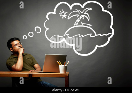 Man dreaming of island in the sun - Stock Photo
