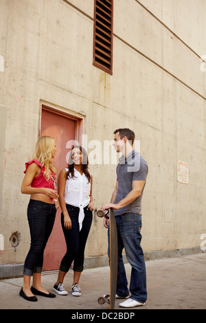 People chatting in back lane - Stock Photo