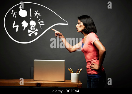 Woman pointing and shouting offensively - Stock Photo