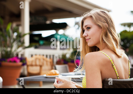Woman in outdoor café relaxing - Stock Photo