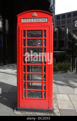 Traditional red telephone box, London, UK - Stock Photo