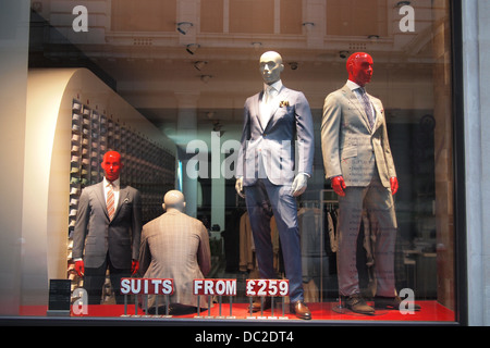 mannequin clothes models in London shop window UK - Stock Photo