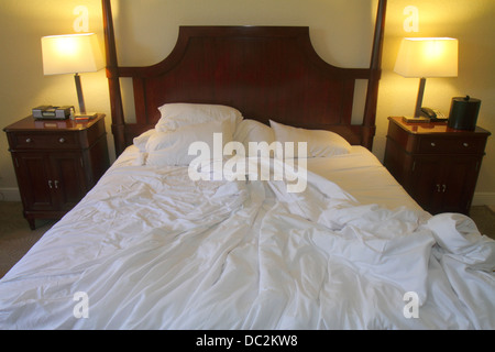 Florida Weston Fort Ft. Lauderdale Bonaventure Resort and & Spa hotel guest room king size bed unmade furniture - Stock Photo