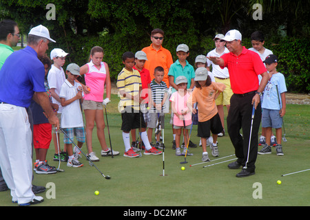 Florida Weston Fort Ft. Lauderdale Bonaventure Country Club boy girl Hispanic man teacher instructor academy lesson - Stock Photo
