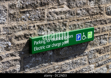 Sign for Disabled Parking and Electric Car Charging Point at the Bowlees Visitor Centre Upper Teesdale County Durham - Stock Photo